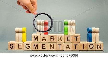 Wooden Blocks With The Word Market Segmentation And Multicolored Groups Of People. Target Audience,