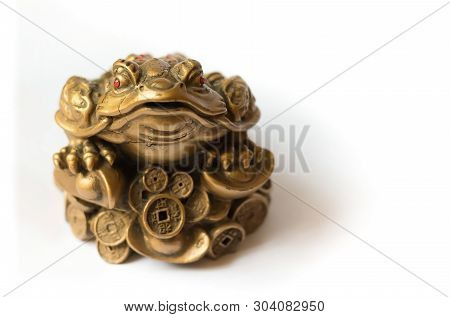 Cash Mascot - Chan Chu - A Gold Frog Figurine Sitting On Coins Isolated On White Background