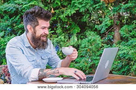 A Freelance Computer Programmer. Bearded Man Working Freelance. Freelancer Enjoying Coffee And Free