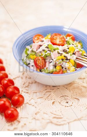 Rice Salad With Pork Steak, Tomatoes, Corn Seeds And Tomatoes.