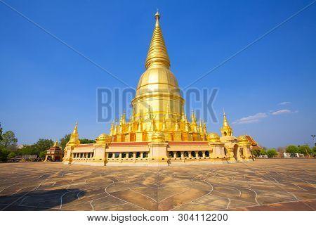 Temple. Buddhist Temple. Phra Maha Chedi Si Wiang Chai Dam District, Lamphun,thailand. Blue Sky