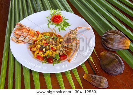 Stir Fried Mini Crayfish With Tamarind Xo Sauce Served On Ceramic Dish In Local Restaurant In Thaila