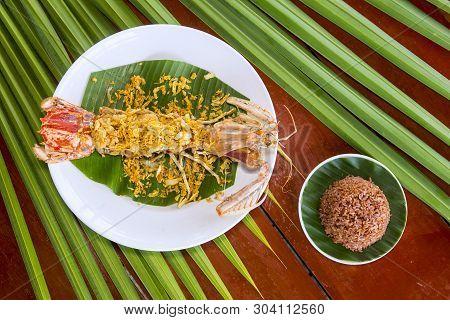Thai Stir Fried Mantis Shrimp With Garlic,and Rice On The Table.
