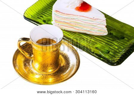 Slice Cream Cake Topped With Fresh Fruit Such As Grapes,   In A Green Plate On A White Background ,