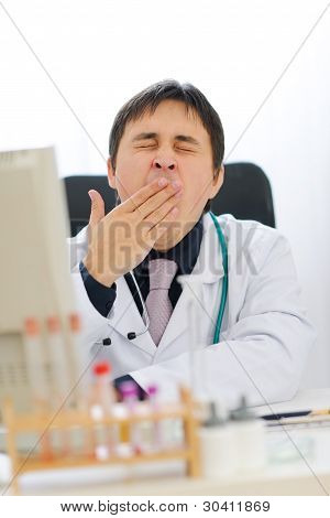 Tired Medical Doctor Yawing