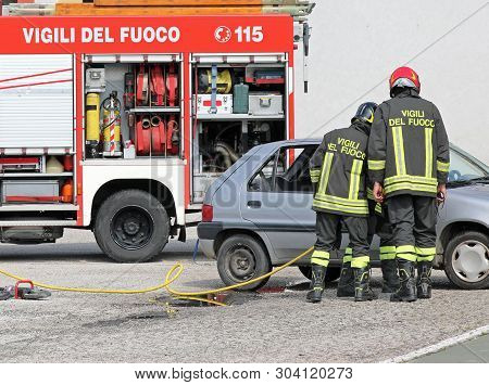 Rome, Rm, Italy - May 23, 2019: Italian Firefighters In Action After The Road Accident With Text Vig