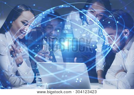 Diverse Team Of Happy Business People Working With Laptop With Double Exposure Of Global Digital Wor