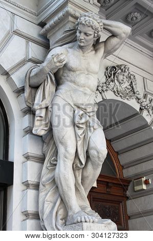 Brawny Statue Supporting A Column On A Renaissance Palace. Metaphor Of Power