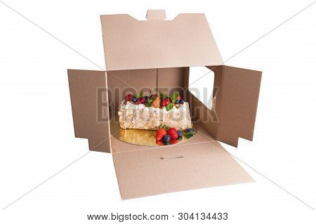 Sponge Cake With Berries In A Cardboard Box Isolated