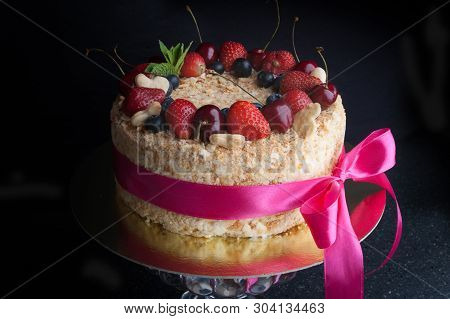 Sponge Cake With Berries On Dark Background