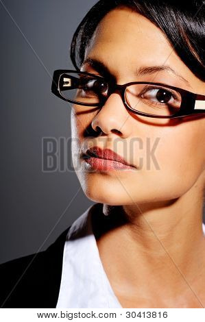 Asian woman in business suit with spectacles