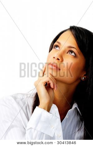 Thoughtful businesswoman touching her chin and looking up, isolated on white