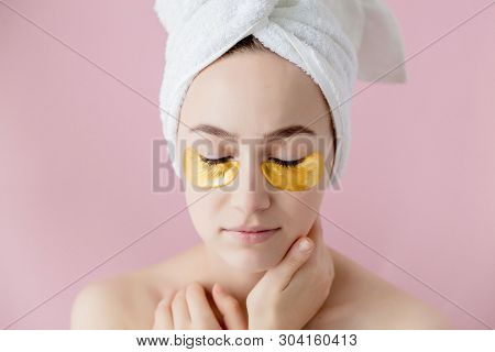Portrait Of Beauty Woman With Eye Patches On Pink Background. Woman Beauty Face With Mask Under Eyes