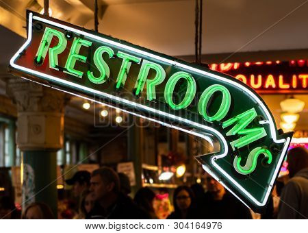 Seattle, United States: October 5, 2018: Neon Restroom Sign Pointing Down In Public Market