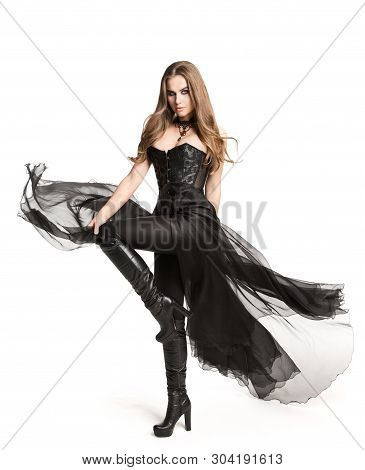 Fashion Model Black Corset Dress Leather Boots, Beautiful Woman In Gothic Gown Isolated Over White B