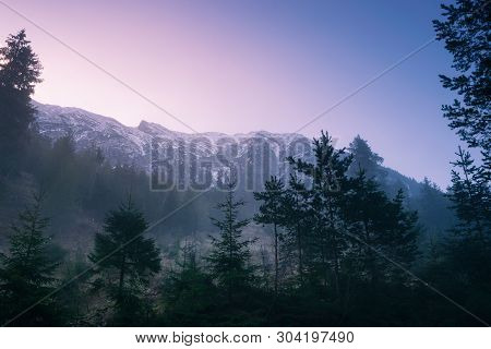 Sunrise In Mountain Landscape. Mountain In Sunrise. Sunrise In Mountain Forest Landscape. Forest And