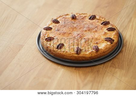 A Delicious Home Made Pecan Tart On A Wooden Counter Top