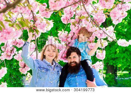 Spring Fashion Family In Spring Garden. Springtime. Summertime. Happy Couple In Flowering Trees. Mot