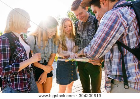 People Travel, Vacation, Holidays, Friendship, City Tour. Friends Travelers Searching Place To Go At