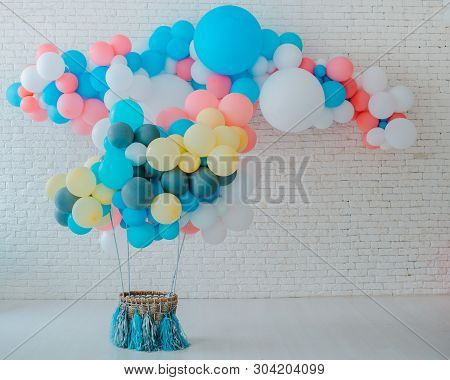 Balloons Basket For Air Flight On White Brick Background With Bright Blue Pink Background With Free