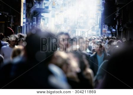 large group of people walking in rush hour on busy city street