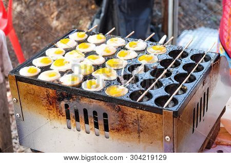 Fried Quail Eggs On The Stove - Delicious Street Food In Thailand Concept.
