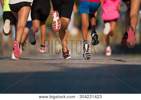 Running Children, Young Athletes Run In A Kids Run Race,running On City Road Detail On Legs,running