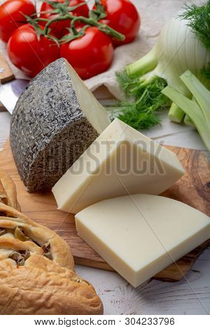 Italian Cheeses, Mature Tuscan Pecorino Sheep Cheese And Provolone Dolce Cow Cheese Served With Oliv