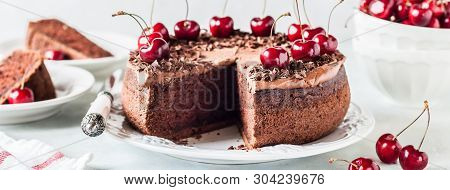 Sliced Chocolate Cake Decorated With Chocolate Shavings And Sweet Cherries, Banner
