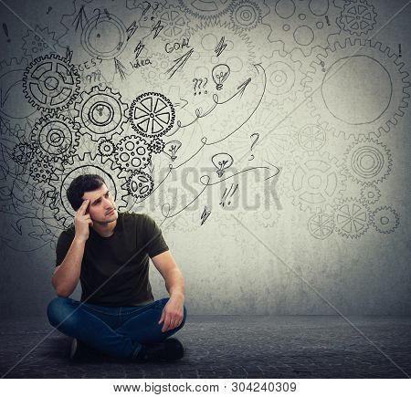 Man Sitting On The Floor Hard Thinking, Find A Solution To Solve Problem. Different Imagination, Alt