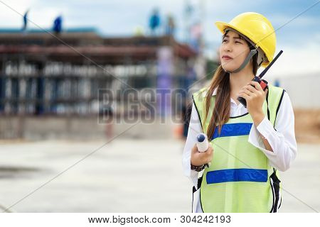 Civil Engineering Is Using Radio Communication. Contact The Site For Work On The Construction Of The