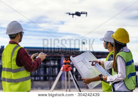 Civil Engineering Flying Drone Over Construction Site Survey For Land And Building Project.