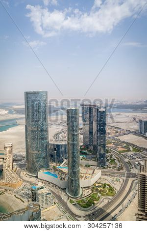 Aerial Drone Shot Of Al Reem Island Sun, Sky Towers And Gate Tower Landmarks In Abu Dhabi City, Uae