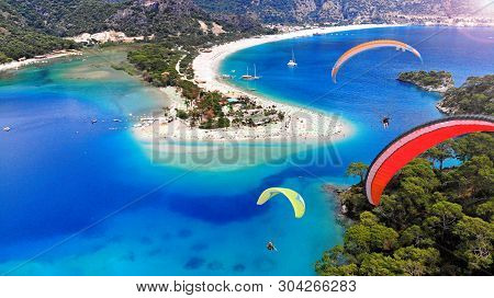 Paragliding Above The Oludeniz, Turkey. Blue Lagoon Beach, Aerial.
