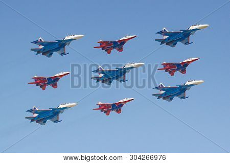 Moscow, Russia - May 07, 2019: Fighters Su-30sm And Mig-29 Of Russian Knights And Swifts Aerobatic T