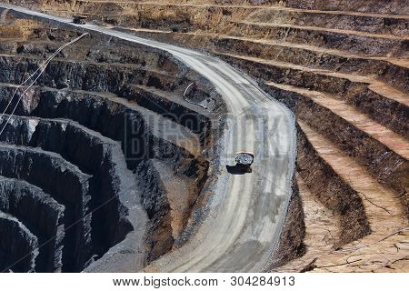 Two Trucks Transport Gold Ore From Open Cast Mine. Barrick Cowal Gold Mine In New South Wales,  Aust