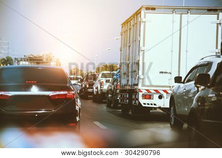 Traffic, Cars On Highway Road On The Countryside On Sunset Evening. Car Street Road Traffic Transpor