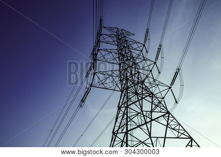 Natural Gas Pipe Line On Silhouette Sunset Sky, Electricity Pylon With Shadow Of Tree In Dawn Time,