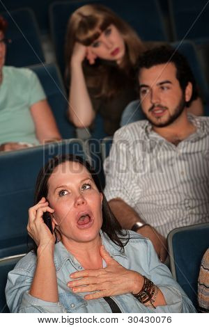 Talking Loudly In A Theater