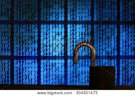 Opened Padlock In Front Of Binary Code Blocks Background. Cyberspace Computer Security Breached. Int