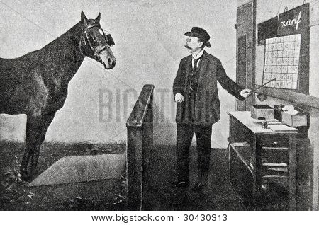 "Man trains a horse to read. Illustration from ""Niva"" magazine, publishing house A.F. Marx, St. Petersburg, Russia, 1913 poster"