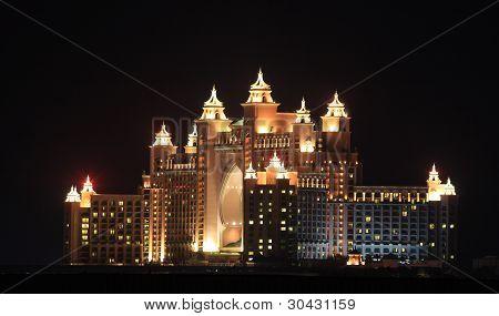 Atlantis Hotel illuminated at night. Palm Jumeirah Dubai United Arab Emirates poster