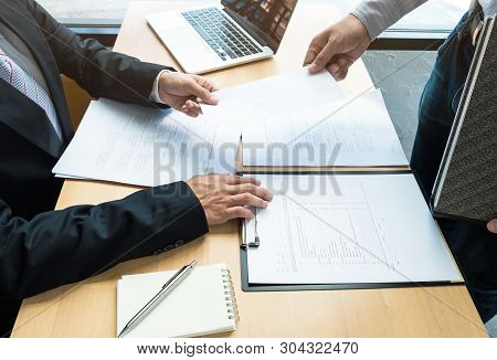 Boss received a letter of resignation from employee on the table in the office. resignation concept. poster