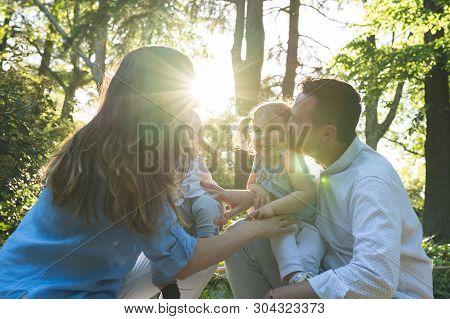 Happy Hispanic Family Having Fun Together Outdoors.