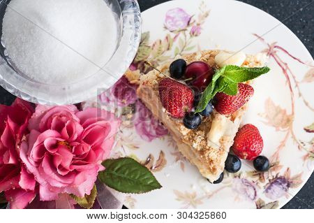A Piece Of Cake Napoleon On Plate With Berries