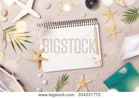 Travelers Notebook With Accessories On Sand Background Top View. Planning Summer Holidays, Trip And