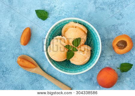 Homemade Apricot Ice Cream , Sorbet With Ripe Apricots And Mint Leaves. Top View
