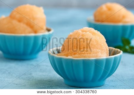 Homemade Melon, Apricot Or Peach Ice Cream , Sorbet In Bowl . Closeup