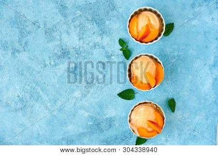 Homemade Apricot Ice Cream , Sorbet With Ripe Apricots And Mint Leaves. Top View , Copy Space