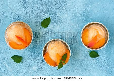 Homemade Apricot Ice Cream , Sorbet With Ripe Apricots And Mint Leaves. Top View  With Copy Space